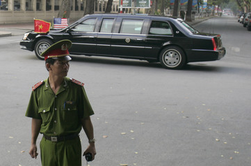 Presidential motorcade leaves a cathedral in Hanoi