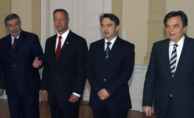 O'Malley, poses with members of Bosnia's three-man inter-ethnic presidency Radmanovic, Komsic and Silajdzic in Sarajevo