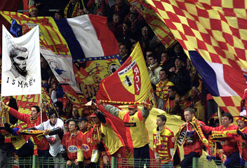 SUPPORTERS OF LENS CHEER THEIR TEAM AFTER VICTORY OVER NANTES IN FRENCHSOCCER MATCH.