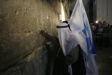 An Israeli Bedouin places a note in the Western Wall in Jerusalem's Old City
