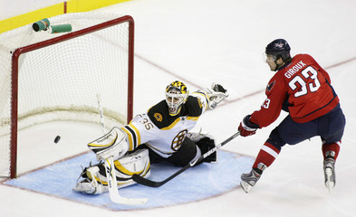Bruins goaltender Manny Fernandez stops Alexandre Giroux on a penalty shot in Washington