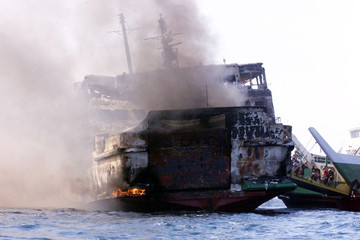 SMOKE BILLOWS FROM BURNING PHILIPPINE SHIP.
