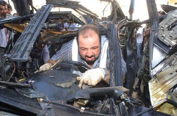 INVESTIGATOR COMBS SITE OF LEBANESE CAR BOMB BLAST.