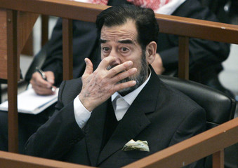 Ousted Iraqi President Saddam listens to the prosecution during the Anfal genocide trial in Baghdad
