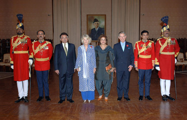 Britain's Prince Charles and Camilla pose with President Musharraf of Pakistan and his wife Begum Sehba Musharra before state dinner in Islamabad