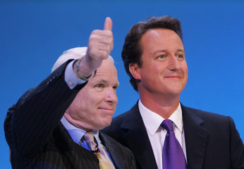 David Cameron, leader of Conservative Party, takes to the stage with U.S. Senator John McCain, on Conservative party conference in Bournemouth