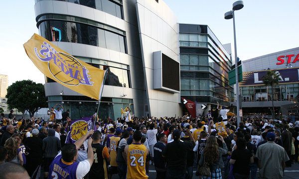Lakers supporters gather outside Staples Center, after the Los Angeles Lakers won their 15th NBA Championship, in Los Angeles