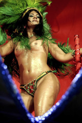 Dancer from Tom Maior samba school performs at the sambodrome during Carnival in Sao Paulo