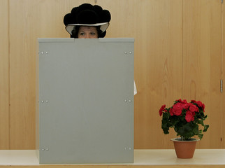 A german woman wearing a traditional Black Forest costume casts her vote during the country's ...