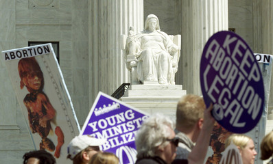 PRO CHOICE MARCHERS PASS THE SUPREME COURT IN WASHINGTON.