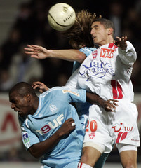 AS Nancy's Chretien fights for the ball with Olympique Marseille's M'Bami during their French Ligue 1 soccer match in Nancy