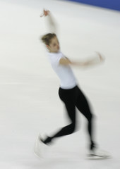 Italy's Kostner practises during a training session before the ISU Grand Prix of Figure Skating final in Turin