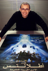 WELL-KNOWN EGYPTIAN MOVIE STAR AHMED EL-SAQA POSES IN FRONT OF THEARABIC VERSION DISNEY'S CARTOON ...
