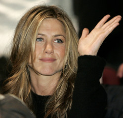 Actress Jennifer Aniston waves at the 2006 Sundance film festival opening night premiere of Sony Pic..