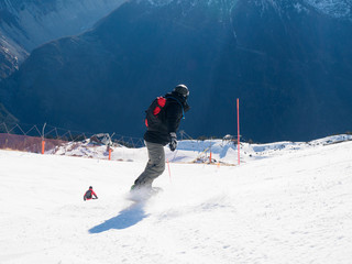 Snowboarder on slope in Alps