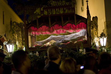 """An effigy of Jesus Christ is displayed in the colonial zone during a """"Via Crucis"""" procession during Holy Week in Santo Domingo"""