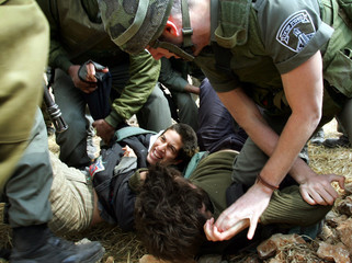 Protesters scuffle with Israeli forces during a joint Israeli-Palestinian demonstration against ...