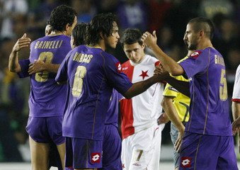 Fiorentina's Dainelli, Vargas and Gamberini celebrate after their Champions League third qualifying round soccer match against Slavia Prague in Prague