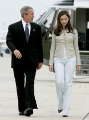 U.S. President George W. Bush and his daughter Barbara walk from the Marine One helicopter to Air Fo..
