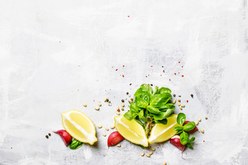 Food background, spices and herbs, basil, garlic and lemon, flat lay
