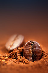Ground Coffee with Roasted Coffee Beans , copyspace.  Espresso Texture macro
