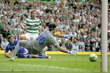 Celtic's Scott McDonald watches as his shot is saved by Dynamo Moscow's Vladimir Denisov during their Champions League qualifying soccer match in Glasgow