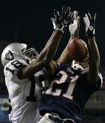 New England Patriots Gay breaks up pass for Oakland Raiders Moss at the Gillette Stadium in Foxboro.