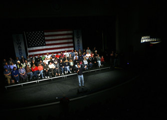 Democratic presidential candidate and former U.S. Senator John Edwards speaks to an audience during a community meeting at the City High School in Iowa City