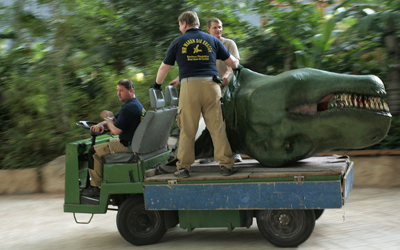 Workers transport the head of a giant model of a Tyrannosaurus Rex at Tropical Islands holiday resort near Brand