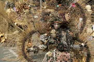 A woman dressed in costume participates in the seventh Jember Fashion Carnival in Jember, East Java