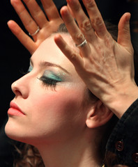 A model's hair is prepared before a fashion show by Lebanese designer Mahfouz in Rome
