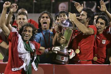 Iran's players celebrate their win over Iraq in West Asian Football Federation Championshipfinal soccer match at Amman International Stadium