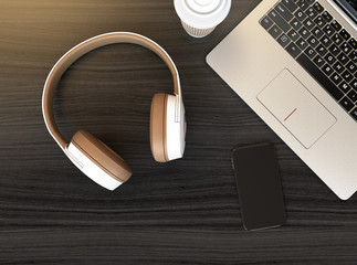 Wireless headphone, laptop PC on dark wooden table. 3D rendering image.
