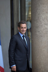 France's President Sarkozy waits for guests at the Elysee Palace in Paris