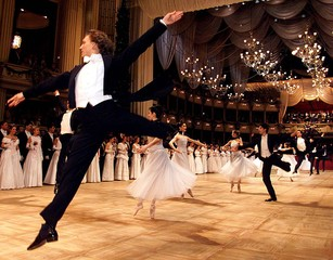 Members of Vienna's state opera ballet dance during the opening ceremony of the annual Opera Ball Ma..
