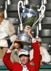 Australia's Rumford holds up the trophy after winning the European Masters golf tournament in Crans-Montana