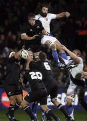 All Black's Brad Thorn and France's Chabal both miss the ball during their international rugby test match in Dunedin