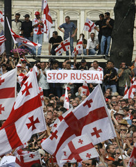 Georgians attend a rally in Tbilisi