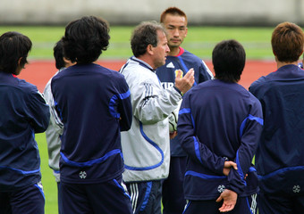 Japan's head coach Zico of Brazil gives directions to players in Bonn
