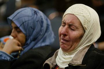 WOMAN CRIES AT MEMORIAL SERVICE IN BROOKLYN FOR SHEIKH AHMED YASSIN.