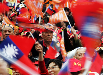 Protestors wave Republic of China flags in a protest rally in Taipei