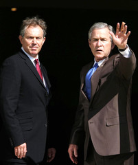 Britain's Prime Minister Tony Blair welcomes American President George W Bush to the first meeting of ...