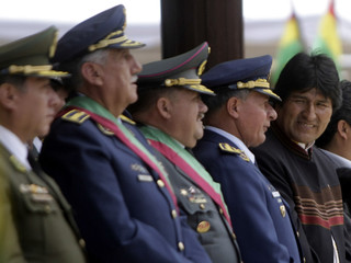Bolivia's President Evo Morales stands next to high ranking officers attending a ceremony commemorating the 198th anniversary of the Bolivian Army in La Paz