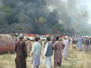AFGHANS WATCH BURNING CARS AT U.S. EMBASSY IN KABUL.