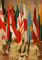 U.S. soldiers from 57-th Signal Battalion take part in a 9/11 commemoration in Baghdad.