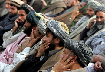 Afghan former insurgents attend a ceremony in Kabul