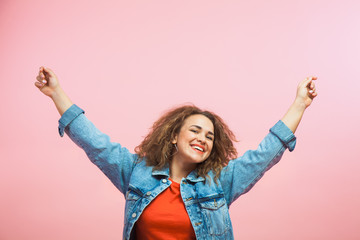 Young woman in jeans coat freedom and happiness