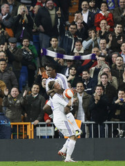 Real Madrid's Royston Drenthe celebrates his goal against Valladolid with teammate Guti during their Spanish first division soccer match at Madrid's Santiago Bernabeu stadium