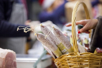 Salami in the basket on the market