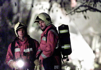 SWISS RESCUE WORKERS AT THE SITE WHERE A CROSSAIR JET CRASHED NEARBIRCHWIL.